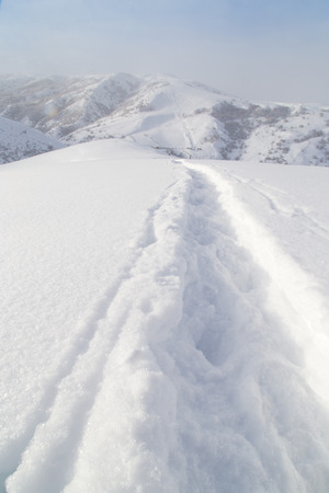 dint: Trail in the snow in the mountains