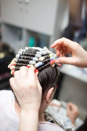 perming: perm in the beauty salon
