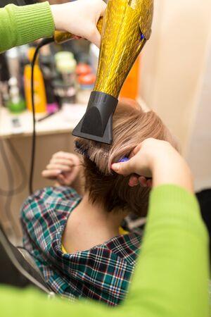 dryer: Hairdresser dries the hair dryer blond  hair Stock Photo