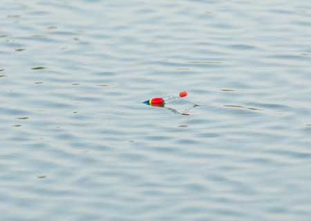 fishing float: Fishing float floating in the water Stock Photo