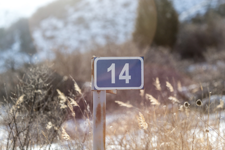 14: 14 sign on the road in nature