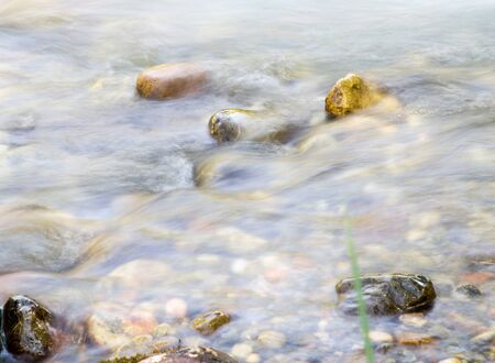 turbulent: background of turbulent water in the mountain river Stock Photo