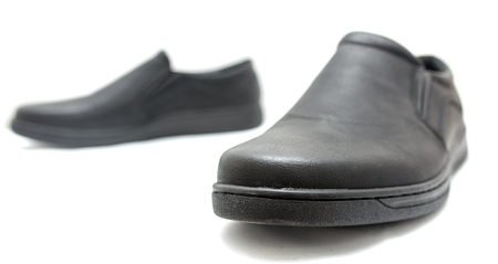 pretty s shiny: Black shoes on a white background Stock Photo