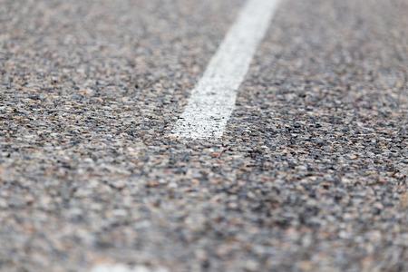 asphalt paving: white line on the asphalt road