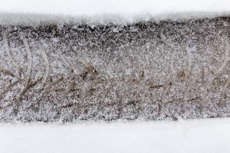 pneu: trace of the wheels on the snow as a background