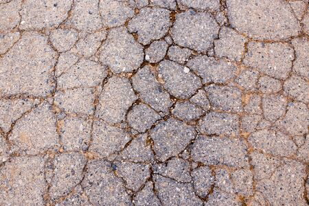 cranny: cracks in the old pavement as a background Stock Photo