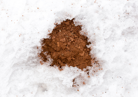 mud snow: snow on red clay in nature