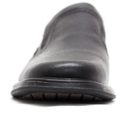 men s feet: Black shoes on a white background Stock Photo