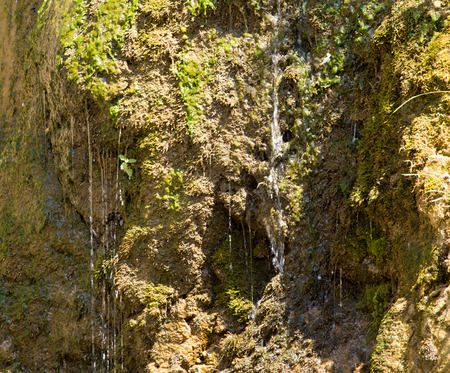 man waterfalls: water from a spring in the mountains