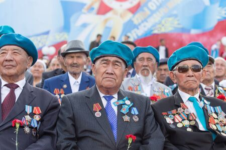 flower parade: SHYMKENT city, KAZAKHSTAN MAY 9, 2015: Veterans of War. Victory Day. The memory of soldiers of the Great Patriotic War. Victory Day celebration in the city of Shymkent, Kazakhstan May 9, 2015 Editorial