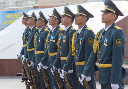 flower parade: SHYMKENT city, KAZAKHSTAN MAY 9, 2015: Statement by the military, the Victory Day, in memory of the soldiers of the Great Patriotic War. Victory Day celebration in the city of Shymkent, Kazakhstan May 9, 2015