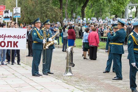 nazi flag: May 9, 2015. The celebration of 70 anniversary of the Victory in the Nazi Germany. Kazakhstan. Shymkent