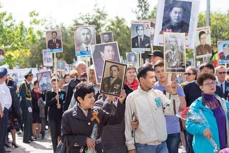 regiment: SHYMKENT city, KAZAKHSTAN MAY 9, 2015: Victory Day in memory of the soldiers of the Great Patriotic War. The photograph izobrazhon Immortal Regiment