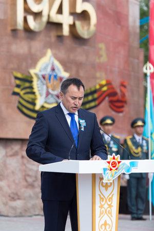 nazi flag: SHYMKENT city, KAZAKHSTAN MAY 9, 2015: ASKAR Myrzakhmet akim of South Kazakhstan region .Den Victory. The memory of soldiers of the Great Patriotic War. Victory Day celebration in the city of Shymkent, Kazakhstan May 9, 2015 Editorial