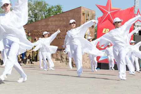 nazi flag: SHYMKENT city, KAZAKHSTAN MAY 9, 2015: Gala concert with the participation of theater actors, Victory Day, in memory of the soldiers of the Great Patriotic War. Victory Day celebration in the city of Shymkent, Kazakhstan May 9, 2015