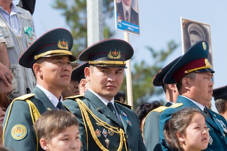 nazi flag: SHYMKENT city, KAZAKHSTAN MAY 9, 2015: Victory Day. The memory of soldiers of the Great Patriotic War. Victory Day celebration in the city of Shymkent, Kazakhstan May 9, 2015