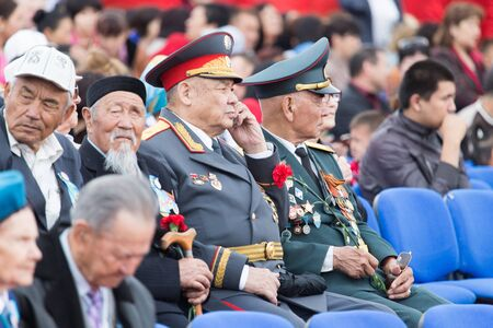 nazi flag: SHYMKENT , KAZAKHSTAN MAY 9, 2015: Victory Day in memory of the soldiers of the Great Patriotic War. Victory Day celebration in the city of Shymkent, Kazakhstan May 9, 2015