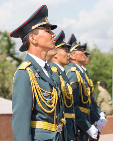 nazi flag: SHYMKENT city, KAZAKHSTAN MAY 9, 2015: Statement by the military, the Victory Day, in memory of the soldiers of the Great Patriotic War. Victory Day celebration in the city of Shymkent, Kazakhstan May 9, 2015