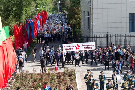 nazi flag: SHYMKENT city, KAZAKHSTAN MAY 9, 2015: Victory Day in memory of the soldiers of the Great Patriotic War. The photograph izobrazhon Immortal Regiment
