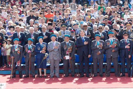 nazi flag: SHYMKENT city, KAZAKHSTAN MAY 9, 2015: Veterans of War. Victory Day. The memory of soldiers of the Great Patriotic War. Victory Day celebration in the city of Shymkent, Kazakhstan May 9, 2015 Editorial