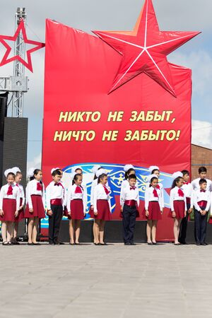 nazi flag: SHYMKENT city, KAZAKHSTAN MAY 9, 2015: Gala concert with the participation of children on Victory Day, in memory of the soldiers of the Great Patriotic War. Victory Day celebration in the city of Shymkent, Kazakhstan May 9, 2015