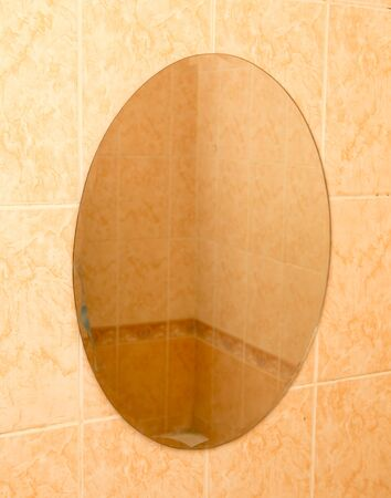 tiled wall: mirror on the tiled wall