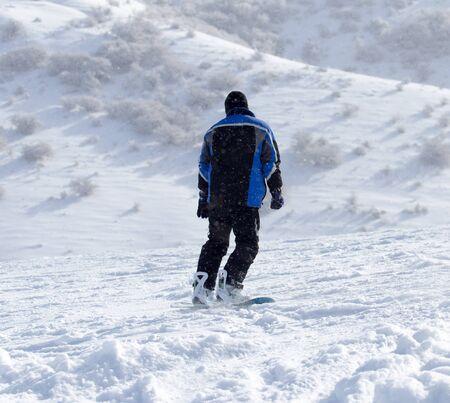 snowboarding: man snowboarding in the winter