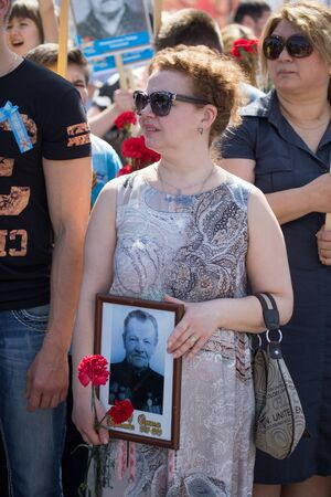 immortal: Shymkent, KAZAKHSTAN May 8, 2016: Tatiana Abramova Artist of Russia in the Immortal regiment. Victory Day celebration in the city of Shymkent, Kazakhstan, May 8, 2016