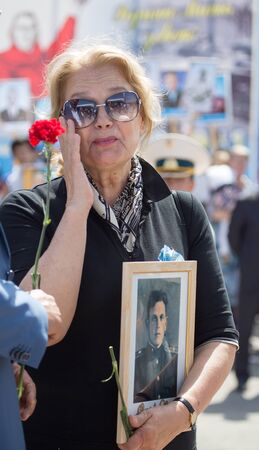 immortal: Shymkent, KAZAKHSTAN May 8, 2016: Irina Alferov Peoples Artist of Russia in the Immortal regiment. Victory Day celebration in the city of Shymkent, Kazakhstan, May 8, 2016