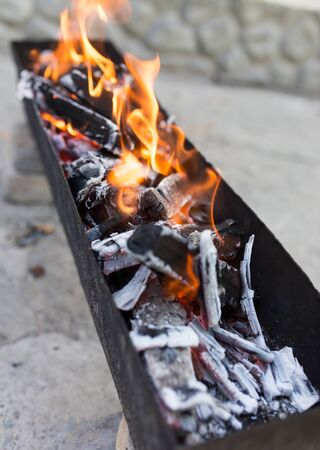 brazier: burning wood in a brazier Stock Photo