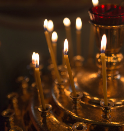 orthodox: candles burning in orthodox church Stock Photo