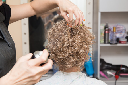 lacquer: Female hair lacquer in a beauty salon Stock Photo