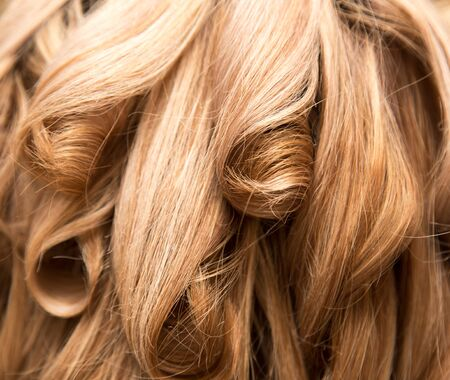 blond streaks: wavy hair as background. texture