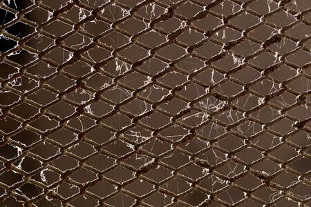 metal grid: old rusty metal grid as a background Stock Photo