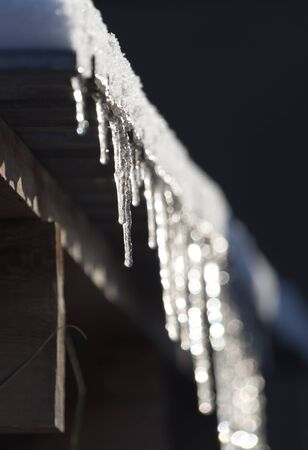 peccadillo: Long and dangerous icicles on a house roof Stock Photo