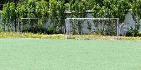 camping pitch: Gate on a football field Stock Photo