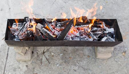 coals: burning wood in a brazier Stock Photo