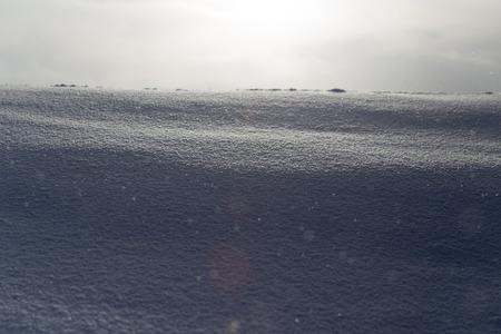 snowy field: snowy field at sunrise Stock Photo