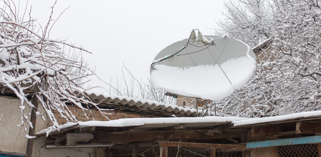 polar station: snow on the satellite dish in the winter Stock Photo