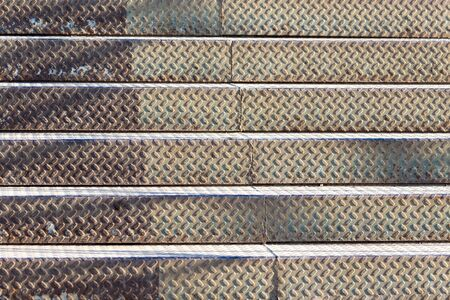 backstairs: metal ladder as background Stock Photo
