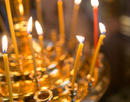 easter candle is burning: candles burning in orthodox church Stock Photo
