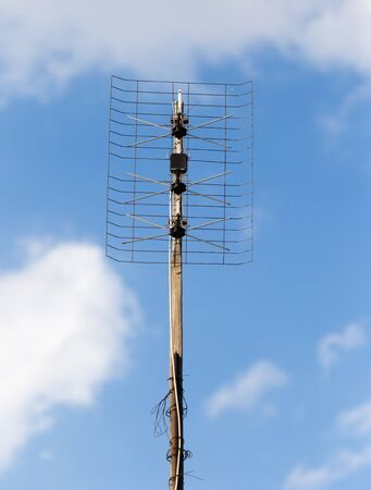 tv antenna: TV antenna on a background of blue sky