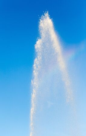 jet stream: water splashing from the fountain in the background of blue sky Foto de archivo