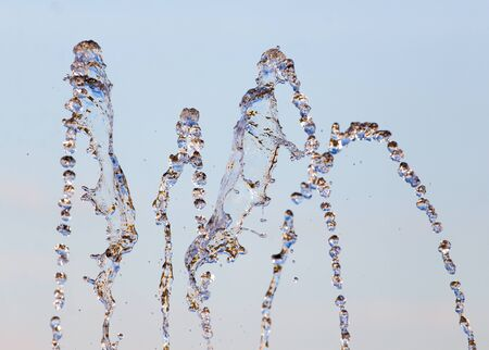 stream  jet: water splashing from the fountain in the background of blue sky Foto de archivo