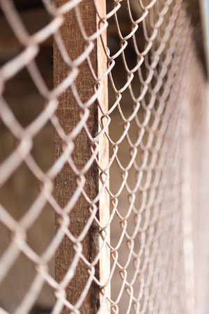 metal mesh: a fence of rusty metal mesh