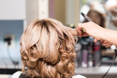Female Hairstyles on curling in a beauty salon Stock Photo