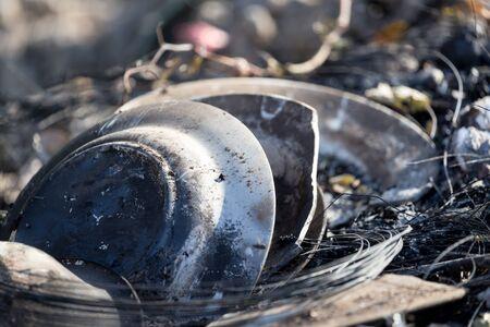 burnt dish on nature as garbage