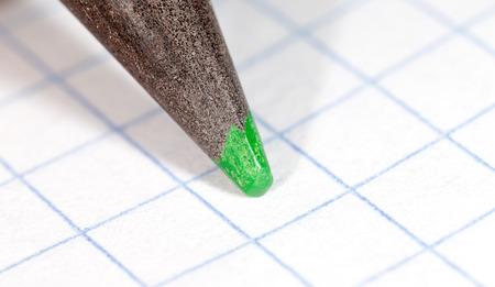 sharpenings: green pencil on paper. macro