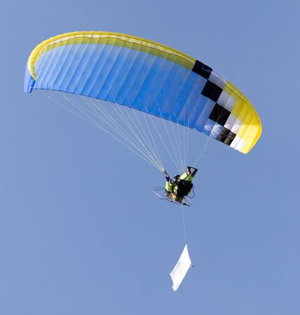 parachute flying in the sky