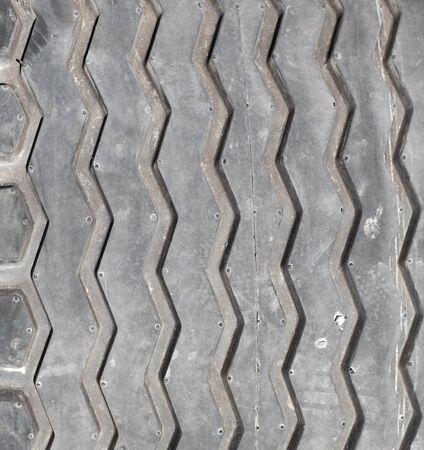 pisar: tread on the wheel as a background Foto de archivo